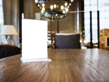 Mock up Menu frame on Table with Restaurant Cafe Interior Royalty Free Stock Photos