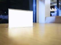 Mock up Menu frame on Table in Restaurant Cafe shop Stock Images
