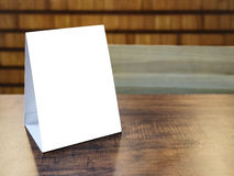 Mock up Menu Frame template on table in Restaurant cafe Stock Images