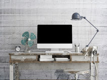 Mock up monitor on table, concrete background Royalty Free Stock Image