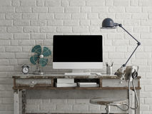 Mock up monitor on table, white brick Stock Images