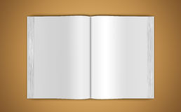Mock-up of an open book on beige background. A mock-up of an open book on beige background, top view Royalty Free Stock Image