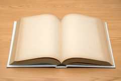 Mock up open book on wood background Royalty Free Stock Photography