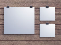 Mock up paper poster hanging  on the blank wall Royalty Free Stock Images