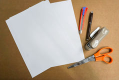 Mock up A4 paper sheet with scissor, pen and office stationary stock photography