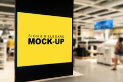 Mock up large billboard on black backdrop. Mock up perspective large horizontal advertising billboard with clipping path on black backdrop at hallway of shopping royalty free stock photography