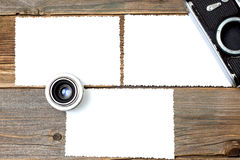 Mock up photo, lens and vintage camera on wooden table Stock Photos