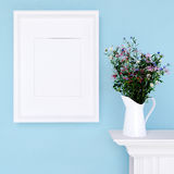 Mock Up Poster And Wildflowers On A Dresser With Blue Wall Royalty Free Stock Photo