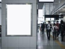 Mock up poster blank board in train station Blur people walking stock image