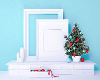 Mock up poster and christmas tree on a dresser Royalty Free Stock Photography
