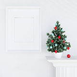 Mock up poster and christmas tree on a dresser Royalty Free Stock Images