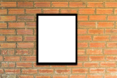 Mock up poster frame and brick wall hipster or vintage. Stock Images
