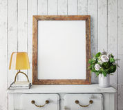 Mock up poster frame with on retro chest of drawers, hipster interior background. 3D render Royalty Free Stock Photos