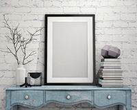 Mock up poster frame on vintage chest of drawers, interior Royalty Free Stock Photo