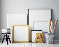 Mock up poster frames in hipster interior background Royalty Free Stock Image