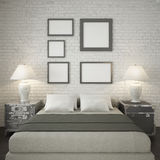 Mock up poster frames at the white brick wall of bedroom Royalty Free Stock Image