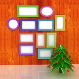 Mock up poster on the wood wall with christmas tree Royalty Free Stock Photos