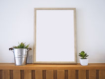 Mock up Poster Wooden Frame with Plants Home decoration Royalty Free Stock Images