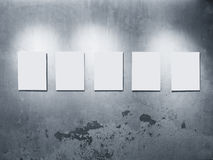 Mock up Posters frames on Grey concrete wall Gallery Display. With lighting decoration Stock Photo