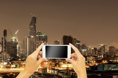 Mock up for advertising with Bangkok building at night time. Mock up screen on smart phone for advertising with Bangkok building at night time stock image