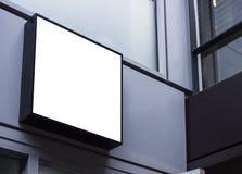 Mock up sign black frame Shop front Building exterior. Mock up sign black frame Shop front display Modern Building exterior Stock Photo