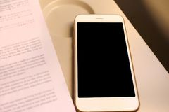 Mockup smartphone and book on plane passenger seat Stock Images
