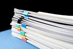 Mock up, stack of papers documents in archives files with paper clips on desk at offices, business concept. Copy space stock image