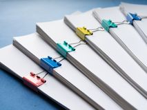 Mock up, stack of papers documents in archives files with paper clips on desk at offices, business concept. Copy space. royalty free stock images