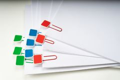 Mock up, stack of papers documents in archives files with paper clips on desk at offices, business concept. Copy space royalty free stock image