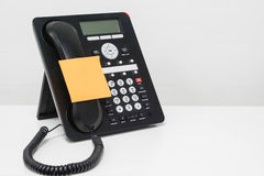 Mock up sticky note on IP phone Stock Photography