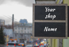 Mock up for street shop or boutique signboard . View of blured street in a cloudy weather Royalty Free Stock Photos