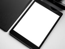 Mock up of tablet on the workspace. 3D rendering Stock Images