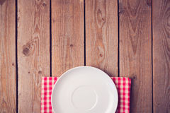Mock up template with empty plate over wooden background. View from above Royalty Free Stock Photography