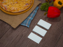 Mock up template pizza on a wooden table. Royalty Free Stock Photos