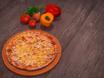 Mock up template pizza on a wooden table. Royalty Free Stock Images