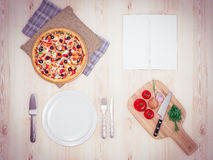 Mock up template pizza on a wooden table. Stock Photos