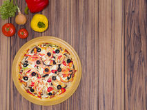 Mock up template pizza on a wooden table. Stock Photo
