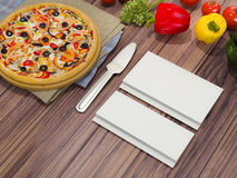 Mock up template pizza on a wooden table. Stock Image
