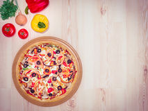 Mock up template pizza on a wooden table. Royalty Free Stock Image