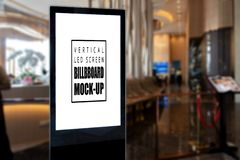 Mock up vertical advertising billboard at entrance of restaurant. Mock up blank vertical advertising billboard or signboard in frame with clipping path at royalty free stock photos