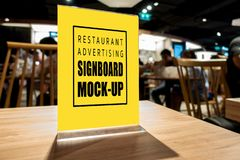 Mock up vertical advertising signboard acrylic frame in restaurant. Mock up blank perspective vertical advertising signboard in acrylic frame with clipping path stock image