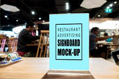 Mock up vertical advertising signboard acrylic frame in restaurant. Mock up blank perspective vertical advertising signboard in acrylic frame with clipping path stock photography