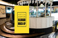 Mock up vertical advertising stand front of booth tea. Mock up vertical blank billboard standing with clipping path at front of tea booth in shopping mall royalty free stock photography
