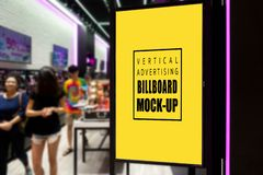 Mock up vertical billboard at entrance of shopping mall. Mock up perspective blank vertical advertising signboard in black frame with clipping path at entrance stock photo