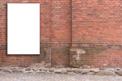 Mock up. Vertical blank billboard, advertising, public information board on old red brick wall Stock Photo