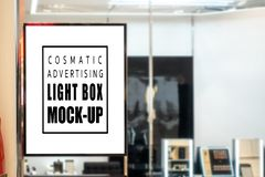 Free Mock Up Vertical Signboard On Glass Panel Of Cosmetic Shop Stock Photos - 149255853