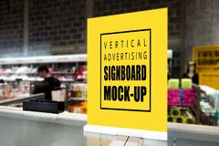 Mock up vertical signboard standing on counter supermarket. Mock up perspective blank vertical signboard with clipping path standing on glass counter in stock photos