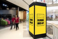 Mock up vertical signboard viewed in two ways. Mock up of tall signboard blank yellow with clipping path on large advertising box for information in mall and royalty free stock photography