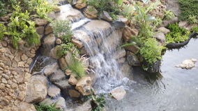 Mock up waterfall in the park stock video