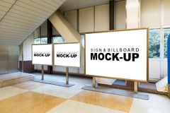 The mock up white billboard with metal frame. Three mock up blank white billboard with metal frame and stand in building for advertising or information with Stock Photos
